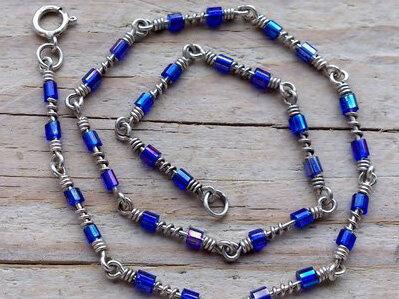 enkelketting zilver met glaskraaltjes donkerblauw