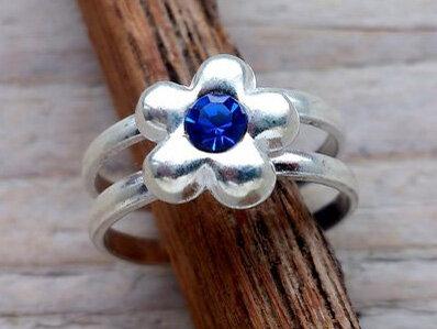 teenring zilver bloem blauw (maat 15mm)